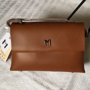 "Melie Bianco ""Riley"" crossbody bag in Saddle color"